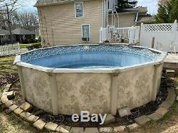 18 feet, 52 height, round pool, new liner, water pump, filter and heat pump